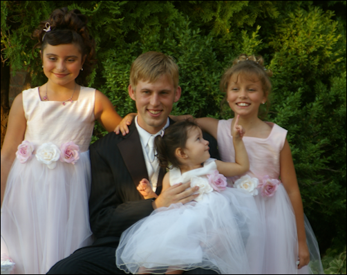 Cody with the flower girls.